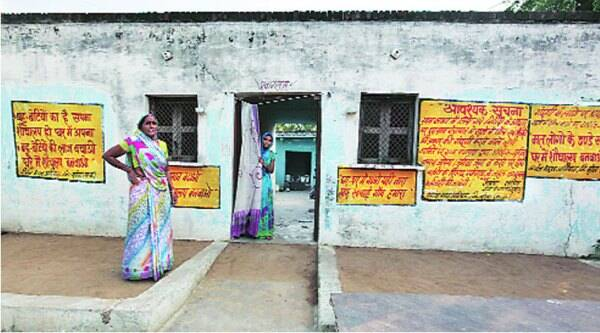 Meera Bhadoria outside her home in Nadkapura village, painted with slogans on sanitation. ( Source: Express photo by Renuka Puri )