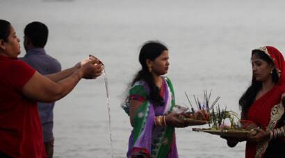 Devotees offer prayers on Chhath Puja ghat