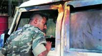 On bomb search, police team attacked with bombs,bricks