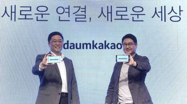In this Oct. 1, 2014 photo released by Daum Kakao, Saehoon Choi, left, and Sirgoo Lee, the two co-CEOs of Daum Kakao, an Internet portal and app developer, show their company's new logo during a press conference in Seoul, South Korea. (Source: AP)