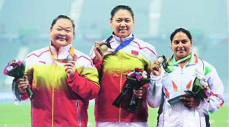 China's Zhang Weinxiu (centre), who won the gold medal with a throw of 77.33m on September 28, flunked the dope test. It meant an upgrade for her compatriot Wang Zheng and India's Manju Bala (right).