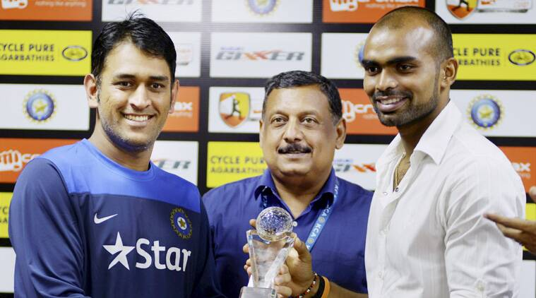 Sreejesh, goalkeeper of Asian Games gold medal winning hockey team, being felicitated by Indian cricket team captain MS Dhoni on Tuesday. (Source: PTI)