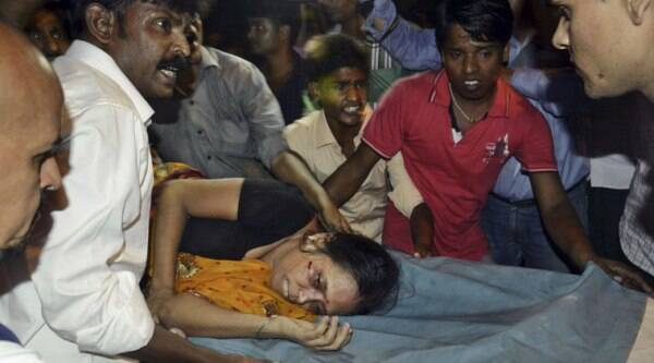 An Injured woman is carried on a stretcher to a hospital for treatment in Patna, India on Friday, (Source: PTI)