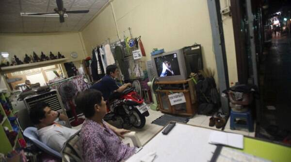 In this Sept. 30, 2014 photo, a Thai family watches a soap opera on television in Bangkok, Thailand. (Source: AP)