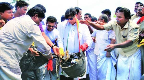 Tharoor during the cleanliness campaign in Thiruvananthapuram on Saturday. (Express)