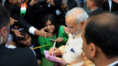 Narendra Modi signs autographs, meets children in US