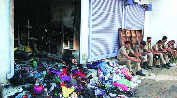 Police guard gutted shops at Bhangar in South 24-Parganas on Saturday. (Express)