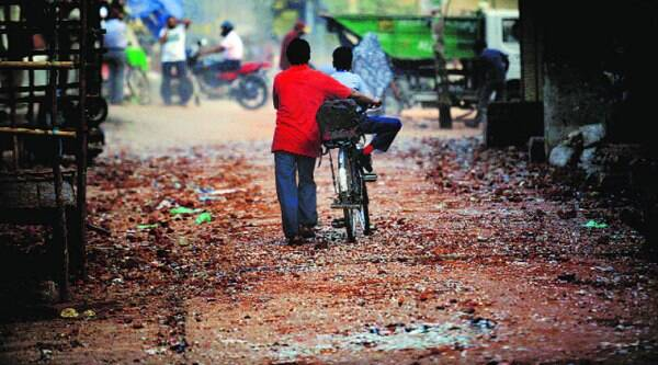 A lane in Trilokpuri littered with bricks and broken glass, in New Delhi on Monday.(PRAVEEN KHANNA)