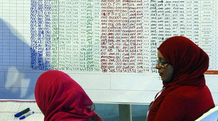 Civil servants sit at results from the Tunis region parliamentary elections in a Tunis voting center, Monday, Oct. 27, 2014. (Source: AP)