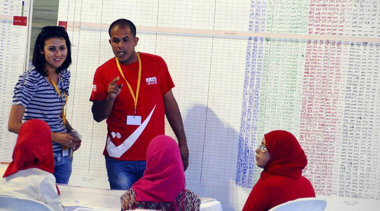 Civil servants discuss at results from the Tunis region parliamentary elections in a Tunis voting center, Monday, Oct. 27, 2014. (Source: AP)