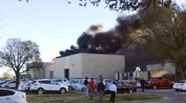 Four dead after small plane crashes into airport building in US