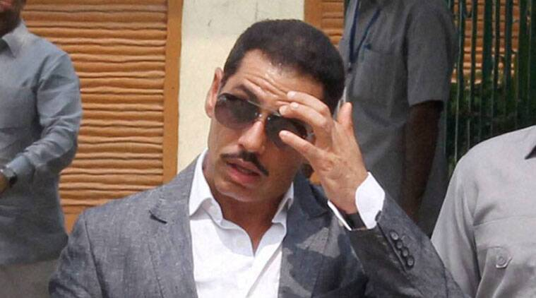 Congress president Sonia Gandhi's son-in-law Robert Vadra on Saturday lost his cool and angrily pushed microphone.