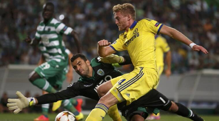 Sporting Lisbon's goalkeeper Rui Patricio saves a shot from Chelsea's Andre Schurrle during their Champions League Group G soccer(Source: Reuters)