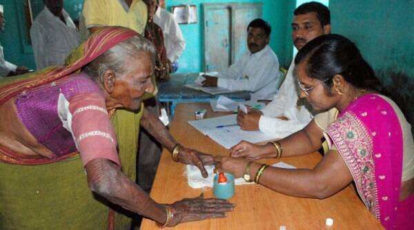 A 100 year old woman cast her vote for the Assembly elections at a polling booth in Karad on Wednesday. (Source: PTI)