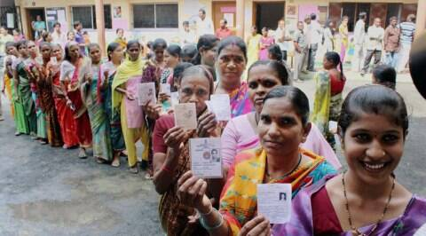 Voters showing their voter identity card before casting their votes at a polling station in Nagpur on Wednesday. (Source: PTI)