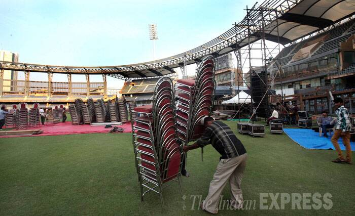 Chairs being laid for the ceremony, which will also be attended by PM Narendra Modi.  (Source: Express Photo By Pradip Das)