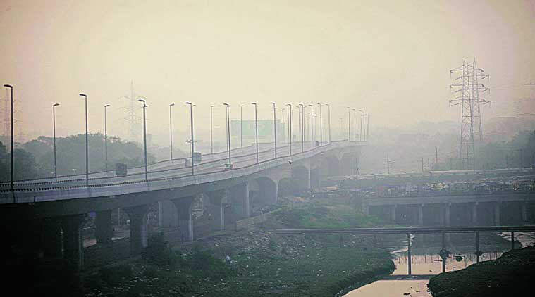 Smog over Barapullah flyover on Friday, a day after Diwali. (Source: Express photo by Oinam Anand)