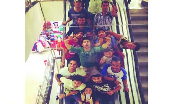 The crew of ABCD2  take a photo while riding down the escalator