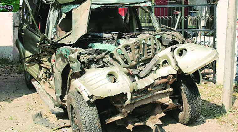 So violent was the impact that a crane and cutting equipment had to be used to extricate the bodies from the Scorpio. (Source: Express photo by Gajendra Yadav)