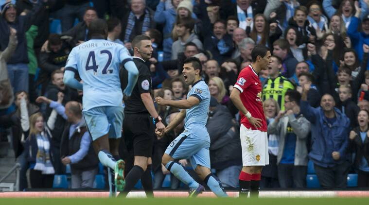 Manchester City's Sergio Aguero, centre, celebrates after scoring against Manchester United during their English Premier League soccer match (Source: AP)