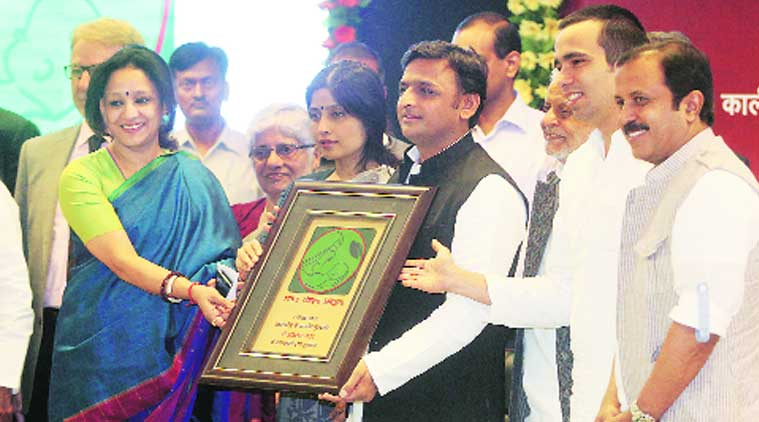 Chief Minister Akhilesh Yadav along with wife and Kannauj MP Dimple Yadav launches the logo of State Nutrition Mission Policy, at his official residence in Lucknow on Saturday. (Source: Express photo by Vishal Srivastav)