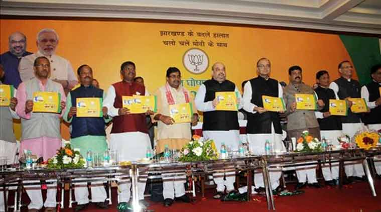 BJP National President Amit Shah, Union Ministers Arun Jaitley and Dharmendra Pradhan and Jharkhand BJP President Ravindra Rai release the party manifesto along with other leaders ahead of Jharkhand Assembly elections in Ranchi on Tuesday. (PTI Photo)