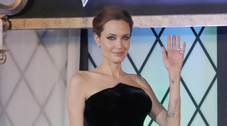 Angelina Jolie shared the news in a video, saying she will not be attending the premiere of her upcoming directorial venture 'Unbroken'. (Source: AP)