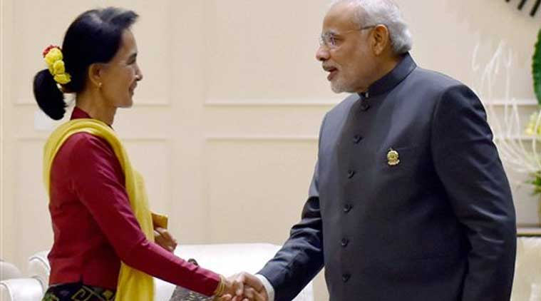 Prime Minister Narendra Modi shakes hands with Chairperson and General Secretary of the National League for Democracy, Aung San Suu Kyi during a meeting at Nay Pyi Taw in Myanmar on Wednesday. (Source: PTI)