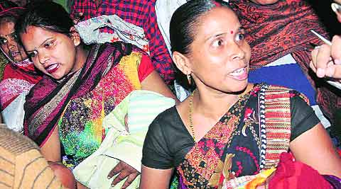 Angry mothers with their babies at the Civil Hospital in Ludhiana on Monday. (Source: Gurmeet Singh)