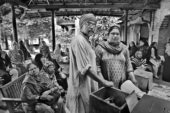 """Sathyu (left) went to Bhopal as a volunteer a day after the gas leak and never left. Today, he is a founder member of the Bhopal Group for Information and Action and the Sambhavna Trust.   In these 30 years, Sathyu has been a lynchpin for gas survivors, their children, and those affected by water contamination caused by Union Carbide factory operations.  """"The disaster occurred essentially because the government prioritized foreign investment over the life and health of ordinary people,"""" he says, adding: """"The more awareness spreads on the continuing disaster in Bhopal, the more we will move towards achieving what we are still trying to achieve. Most of our hope is bestowed in public support."""" Rachna Dhingra (R) left her job with a multinational management consultancy firm in the USA for Bhopal in 2003 after realising she could do something to help the communities there. She's remained ever since and today is a member of the Bhopal Group for Information and Action. """"Corporations cannot just come, kill and pollute, and leave without any kind of responsibility,"""" she says. (Source: Amnesty International © Raghu Rai / Magnum Photos)"""