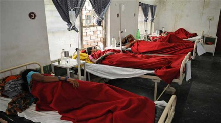 Indian women who underwent sterilization surgeries receive treatment at the District Hospital in Bilaspur, in the central Indian state of Chhattisgarh, Wednesday, Nov. 12, 2014, after at least a dozen died and many others fell ill following similar surgery. (Source: AP)