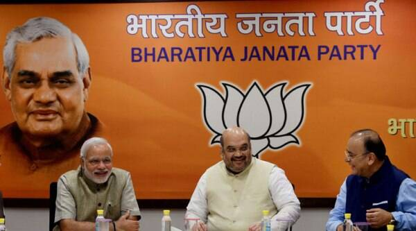 PM Narendra Modi, BJP President Amit Shah and FM Arun Jaitley during the party's Central Election Committee meeting for the upcoming Assembly elections in New Delhi on Sunday. (Source: PTI photo)
