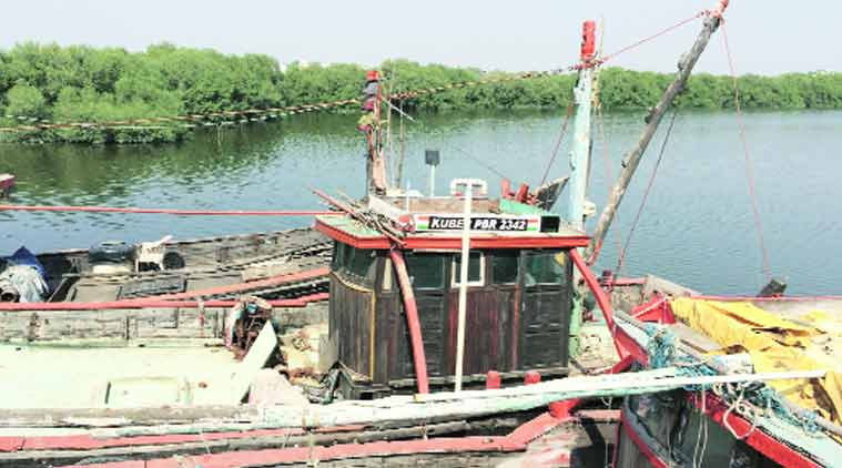 Today, Kuber sits anchored at the back of Porbandar's fishing harbour. (Source: Express photo by Praveen Swami)
