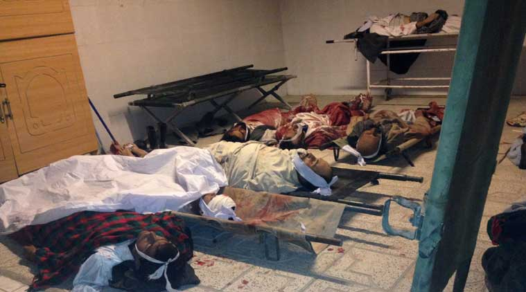 Bodies of civilians are laid out a hospital after a suicide attack in the Yahyakhail district of Paktika province east of Kabul, Afghanistan, Sunday, Nov. 23, 2014. (Source: AP)