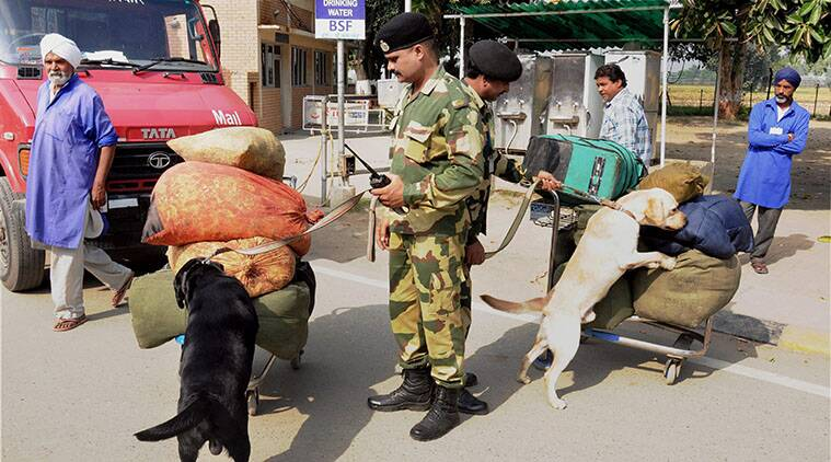 Attari: BSF jawans with sniffer dogs checking luggage of passengers at Attari international border on Monday. The security have been beefed up in the region after the Sunday's suicide bomb attack at Wagah in Pakistan. (Source:  PTI)