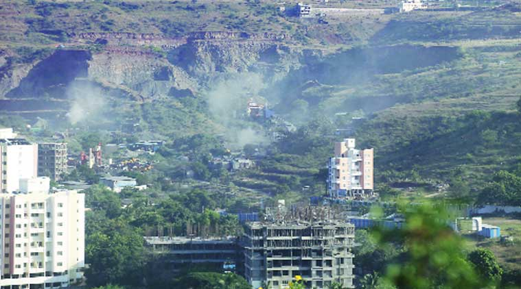 There is rampant construction activity on at hills on the outskirts including Ambegaon-Katraj, near the site of Friday's building collapse. (Source: Express photo by Pavan Khengre)