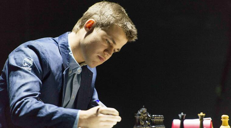 It was a mild surprise when Carlsen started with the Grunfeld defence, to leave the Indian think-tank guessing. (Source: AP file)