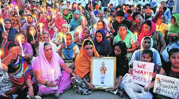 At the candlelight march to seek justice for Mehram in Sector 62, Mohali, on Saturday. (Express photo by Jasbir Malhi)