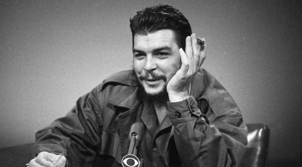 """In this Dec. 13, 1964 file photo, Cuba's Ernesto """"Che"""" Guevara makes an appearance on """"Face the Nation"""" at CBS-TV studios in New York. (AP Photo)"""