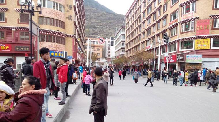In this photo released by China's Xinhua News Agency, locals stand outside after a quake hit Kangding County in Sichuan Province, China Saturday, Nov. 22, 2014. A strong earthquake struck a lightly populated, mountainous area of western China on Saturday, killing at least one person and causing minor damage to buildings, officials and state media said. (Source: AP)