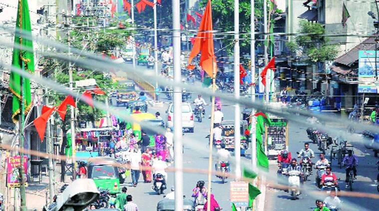 Saffron and green flags mark lanes in clash-affected areas of Vadodara ahead of Muharram. (Source: Express photo Bhupendra Rana)