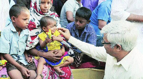 CPM leader Sujan Chakraborty interacts with family members of Korban Shah in Kolkata on Monday. ( Source: PTI )