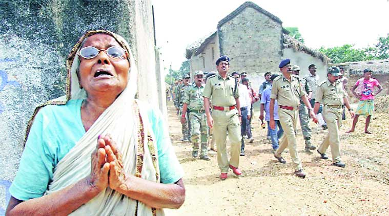 An elderly woman, whose family members have fled fearing violent backlash, wails at Makra village, in Birbhum on Sunday. (Source: PTI)