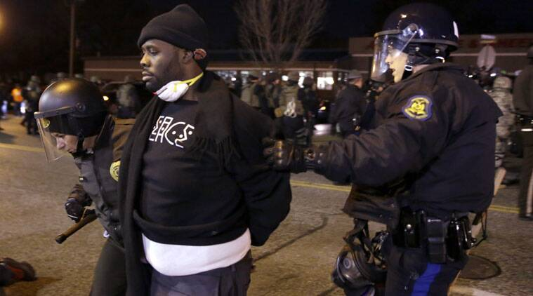 """""""Police in Ferguson issued warning to protesters leave streets. Some protesters ignored warnings. Were taken into custody,"""" St Louis County Police Department tweeted. (Source: AP photo)"""
