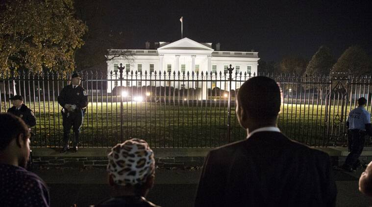 """Four students from Howard University, who asked only to be called """"Mike Brown"""", pray in front of the White House, Monday, Nov. 24, 2014, in Washington, after the Ferguson grand jury decided not to indict police officer Darren Wilson in the shooting death of Michael Brown. (Source: AP)"""