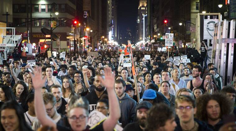 Protestors march up Seventh Avenue towards Times Square after the announcement of the grand jury decision not to indict police officer Darren Wilson in the fatal shooting of Michael Brown, an unarmed 18-year-old black man, Monday, Nov. 24, 2014, in New York. (Source: AP)