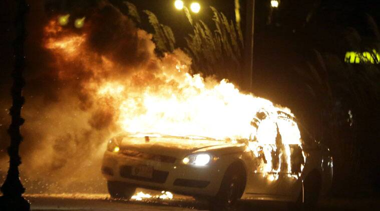 Protesters set a police vehicle ablaze in Ferguson. (Source: AP)