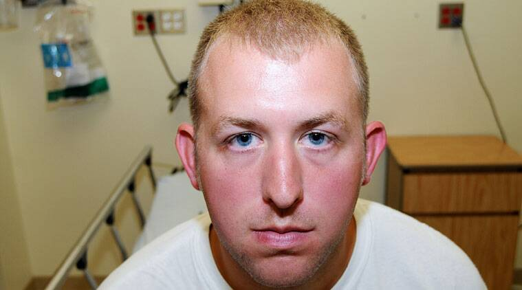 Darren Wilson during his medical examination after he fatally shot Michael Brown, in Ferguson. (Source: AP photo)