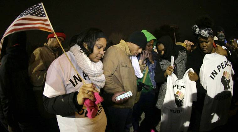 Protesters listen to the announcement of the grand jury decision in Ferguson.