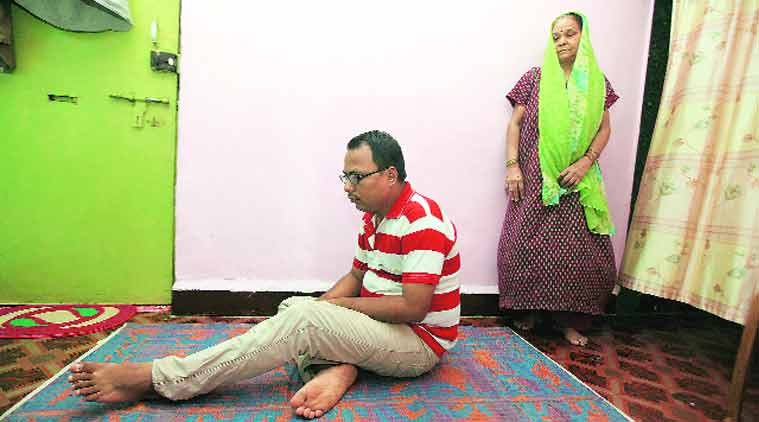Govind and his mother at their Thane flat. (Source: Express photo by Deepak Joshi)